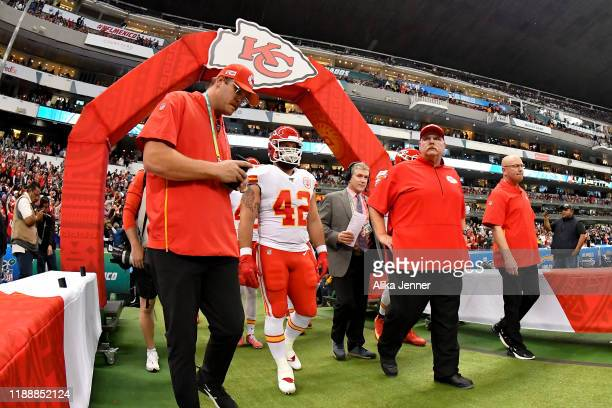 Head coach Andy Reid of the Kansas City Chiefs and Anthony Sherman walk out of the team tunnel before an NFL football game against the Los Angeles...