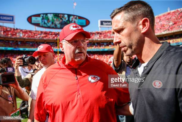 Head coach Andy Reid of the Kansas City Chiefs and head coach Kyle Shanahan of the San Francisco 49ers speak after the game at midfield at Arrowhead...