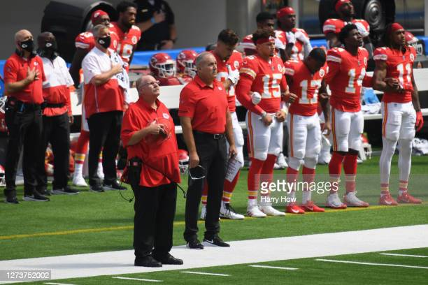 Head coach Andy Reid of the Kansas City Chiefs and his team stands for the U.S. National Anthem before playing against the Los Angeles Chargers...