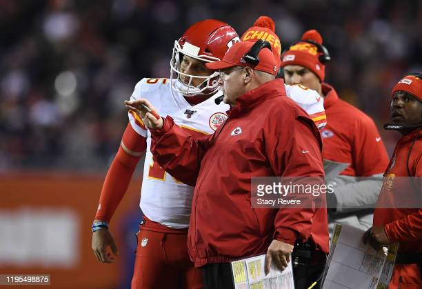Head coach Andy Reid of the Kansas City Chiefs and quarterback Patrick Mahomes talk during a time out in the second quarter of the game against the...