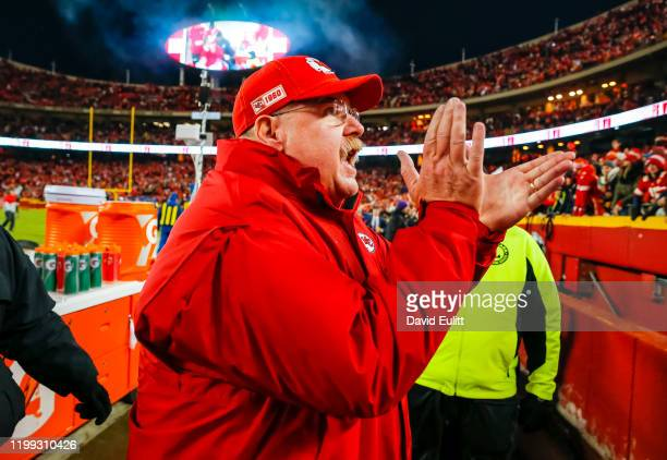 Head coach Andy Reid of the Kansas City Chiefs applauds for the Kansas City fans following the 51-31 victory over the Houston Texans in the AFC...