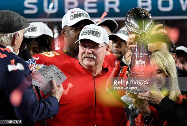 Head Coach Andy Reid of the Kansas City Chiefs celebrates with Terry Bradshaw after the Chiefs defeated the San Francisco 49ers in Super Bowl LIV at...