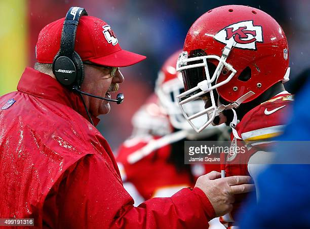 Head coach Andy Reid of the Kansas City Chiefs congratulates outside linebacker Tamba Hali after on 4th down the Chiefs defense prevented the Buffalo...