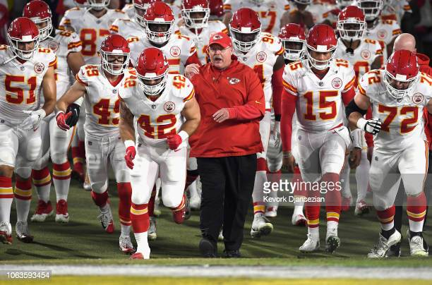 Head coach Andy Reid of the Kansas City Chiefs enters the field with his team before the start of the game against the Los Angeles Rams at Los...