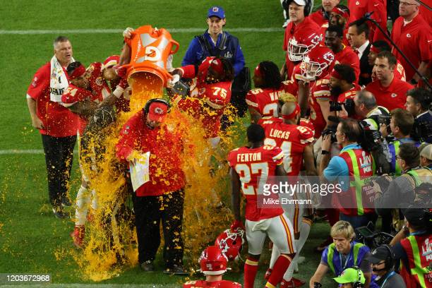 Head coach Andy Reid of the Kansas City Chiefs gets dunked in Gatorade after defeating the San Francisco 49ers 31-20 in Super Bowl LIV at Hard Rock...