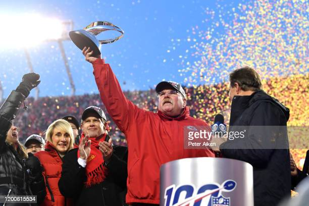 Head coach Andy Reid of the Kansas City Chiefs holds up the Lamar Hunt trophy after defeating the Tennessee Titans in the AFC Championship Game at...