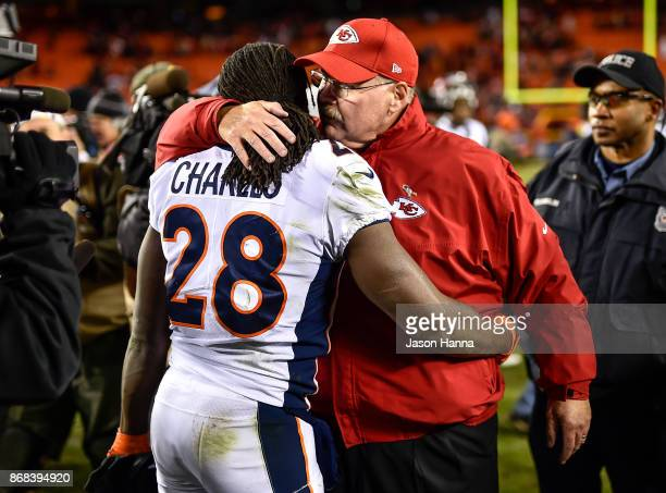 Head coach Andy Reid of the Kansas City Chiefs hugs his former player, and current running back of the Denver Broncos, Jamaal Charles following the...