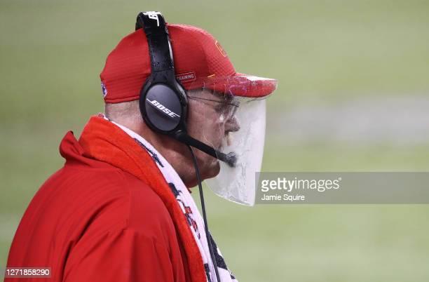 Head coach Andy Reid of the Kansas City Chiefs looks on through a plastic shield during the fourth quarter against the Houston Texans at Arrowhead...