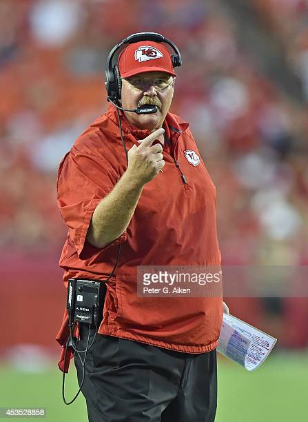 Head coach Andy Reid of the Kansas City Chiefs reacts to a call during the first half against the Cincinnati Bengals at Arrowhead Stadium on August 7...