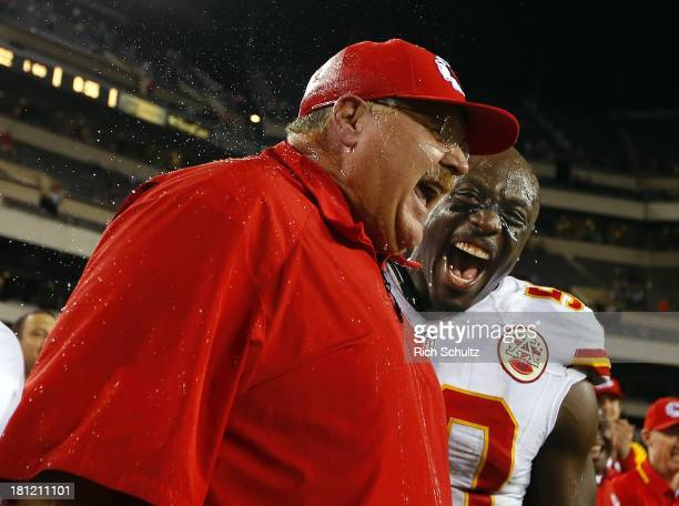 Head coach Andy Reid of the Kansas City Chiefs reacts to getting a Gatorade shower with linebacker Justin Houston after defeating the Philadelphia...