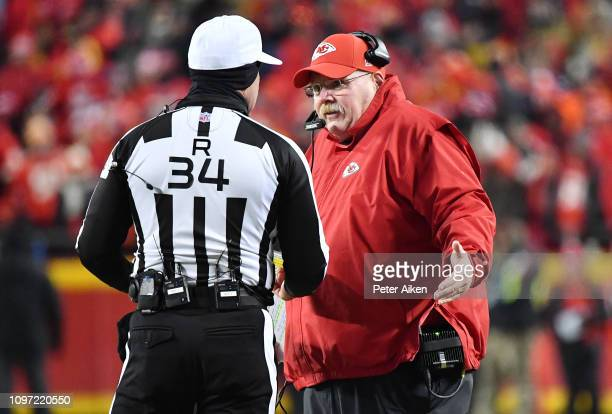 Head coach Andy Reid of the Kansas City Chiefs speaks to referee Clete Blakeman after a call in the fourth quarter against the New England Patriots...