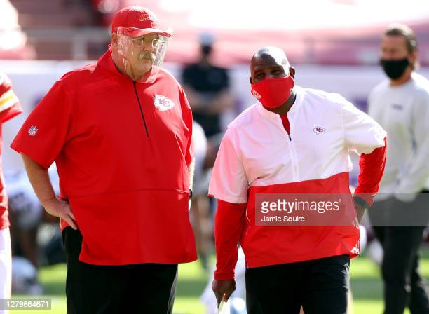 Head coach Andy Reid of the Kansas City Chiefs speaks with offensive coordinator Eric Bieniemy prior to the game against the Las Vegas Raiders at...