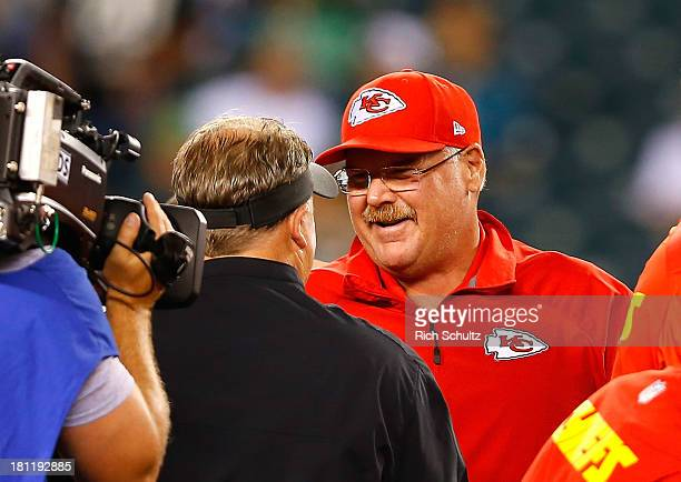 Head coach Andy Reid of the Kansas City Chiefs talks to head coach Chip Kelly of the Philadelphia Eagles prior to the game at Lincoln Financial Field...