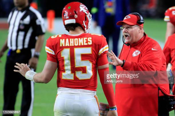Head coach Andy Reid of the Kansas City Chiefs talks to Patrick Mahomes of the Kansas City Chiefs during the fourth quarter in Super Bowl LIV against...