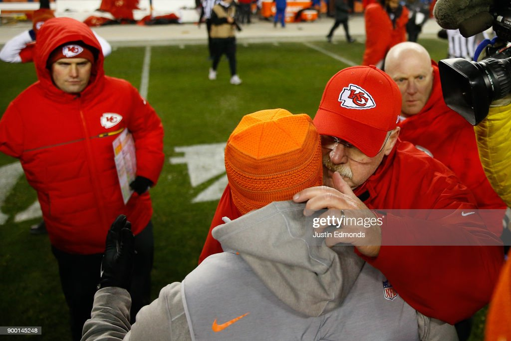 Head coach Andy Reid of the Kansas City Chiefs talks with head coach Vance Joseph of the Denver Broncos after their game at Sports Authority Field at Mile High on December 31, 2017 in Denver, Colorado. The Chiefs defeated the Broncos 27-24.