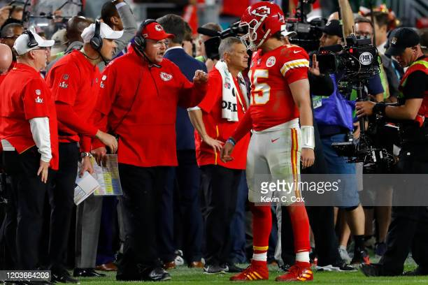 Head coach Andy Reid of the Kansas City Chiefs talks with Patrick Mahomes against the San Francisco 49ers during the fourth quarter in Super Bowl LIV...