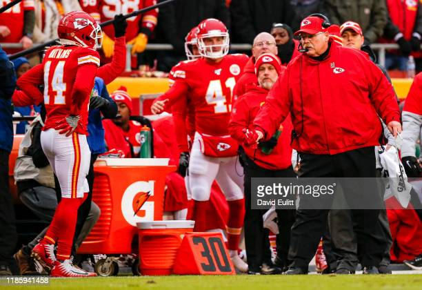 Head coach Andy Reid of the Kansas City Chiefs throws a challenge flag on a replay of pass interference in the first quarter against the Oakland...