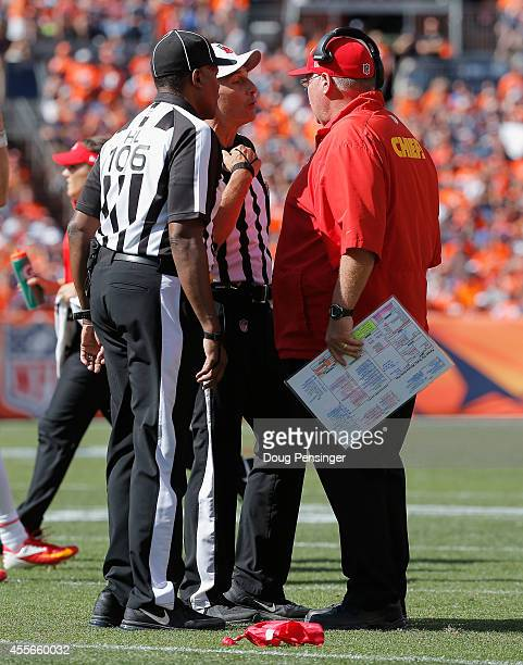 Head coach Andy Reid of the Kansas City Chiefs throws the red to make a coach's challenge with referee Gene Steratore and head linesman Wayne Mackie...