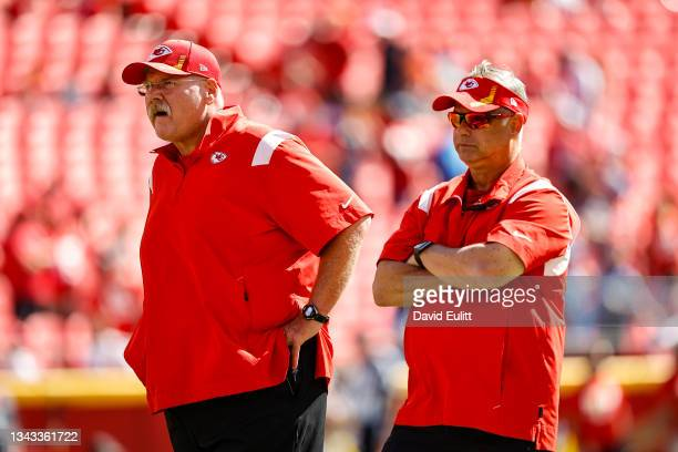 Head coach Andy Reid of the Kansas City Chiefs watches pregame warmups next to vice president of sports medicine and performance Rick Burkholder...