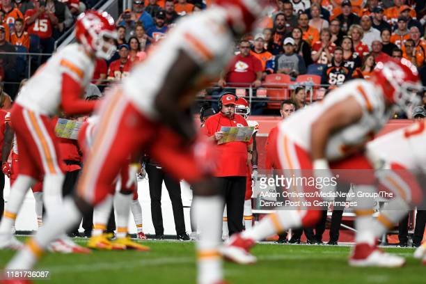 Head coach Andy Reid of the Kansas City Chiefs watches the offense work against the Denver Broncos during the first quarter on Thursday, October 17,...