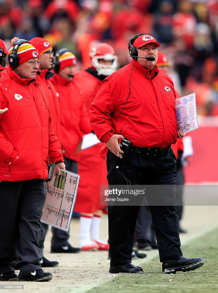 Head coach Andy Reid of the Kansas City Chiefs watches the scoreboard during the game against the Indianapolis Colts at Arrowhead Stadium on December 22, 2013 in Kansas City, Missouri.
