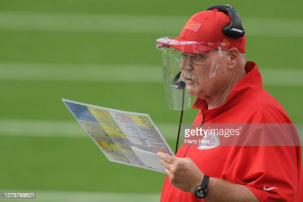 Head coach Andy Reid of the Kansas City Chiefs wears a face shield as he looks on from the sideline against the Los Angeles Chargers during the third...