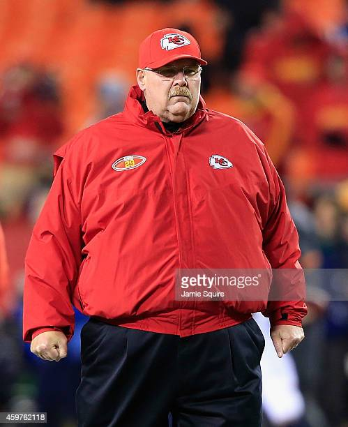 Head coach Andy Reid of the Kansas City Chiefs wears the number 29 on his jacket in support of Eric Berry during warm ups before the game against the...