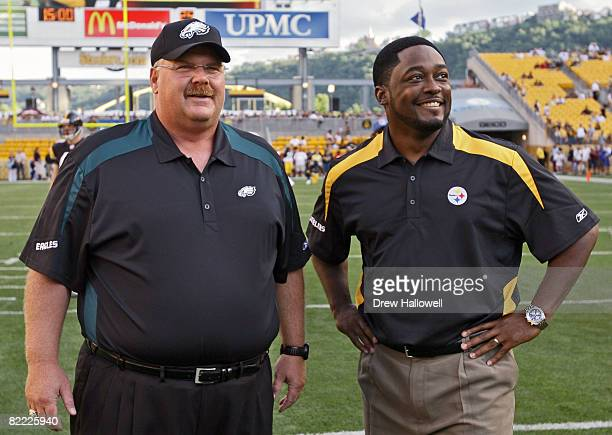 Head coach Andy Reid of the Philadelphia Eagles and head coach Mike Tomlin of the Pittsburgh Steelers watch warmups on August 8 2008 at Heinz Field...