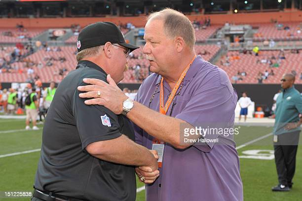 Head coach Andy Reid of the Philadelphia Eagles and president Mike Holmgren of the Cleveland Browns talk at Cleveland Browns Stadium on August 24...