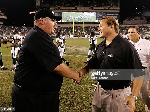Head coach Andy Reid of the Philadelphia Eagles congratulates head coach Eric Mangini of the New York Jets after a preseason game at Lincoln...