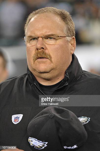Head coach Andy Reid of the Philadelphia Eagles observes the National Anthem during the game against the New York Giants at Lincoln Financial Field...