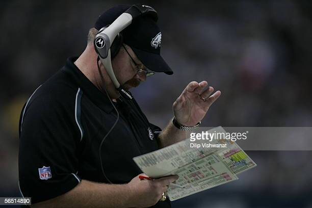 Head Coach Andy Reid of the Philadelphia Eagles reviews his play sheet during the game with the St Louis Rams at the Edward Jones Dome on December 18...
