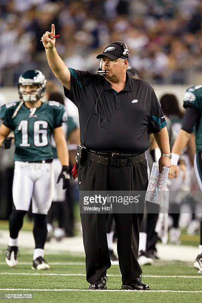 Head Coach Andy Reid of the Philadelphia Eagles signals to go for one point against the Dallas Cowboys at Cowboys Stadium on December 12 2010 in...