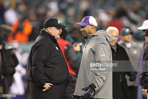 Head coach Andy Reid of the Philadelphia Eagles speaks with head coach Leslie Frazier of the Minnesota Vikings before a game at Lincoln Financial...