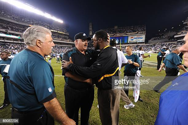 Head coach Andy Reid of the Philadelphia Eagles talks with coach Mike Tomlin of the Pittsburgh Steelers on September 21 2008 at Lincoln Financial...