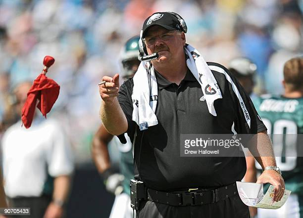 Head coach Andy Reid of the Philadelphia Eagles throws a flag challenging a play during the game against the Carolina Panthers on September 13 2009...
