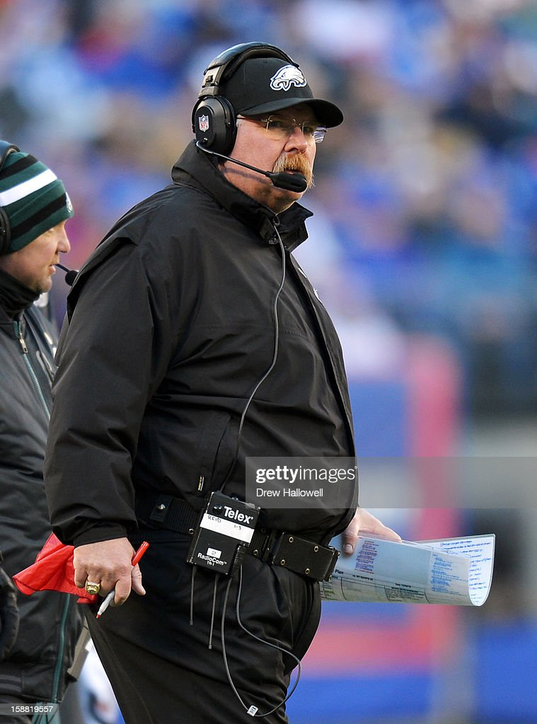Head coach Andy Reid of the Philadelphia Eagles walks the sideline during the game against the New York Giants at MetLife Stadium on December 30, 2012 in East Rutherford, New Jersey. The Giants won 42-7.