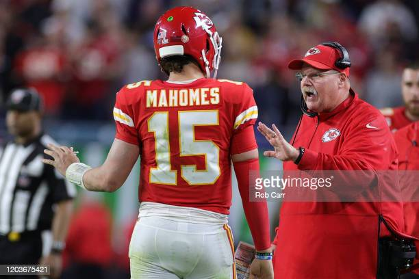 Head coach Andy Reid talks to Patrick Mahomes of the Kansas City Chiefs during the fourth quarter in Super Bowl LIV at Hard Rock Stadium on February...
