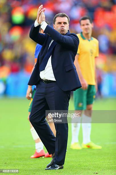 Head coach Ange Postecoglou of Australia acknowledges the fans after a 32 defeat in the 2014 FIFA World Cup Brazil Group B match between Australia...
