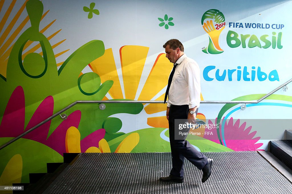 Head coach Ange Postecoglou of Australia walks down in the tunnel after the 0-3 defeat in the 2014 FIFA World Cup Brazil Group B match between Australia and Spain at Arena da Baixada on June 23, 2014 in Curitiba, Brazil.