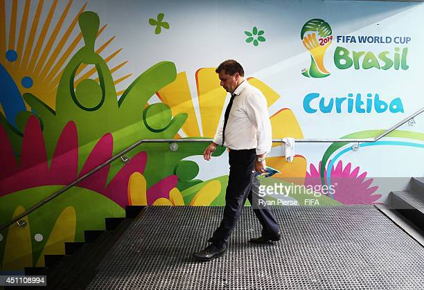 Head coach Ange Postecoglou of Australia walks down in the tunnel after the 03 defeat in the 2014 FIFA World Cup Brazil Group B match between...