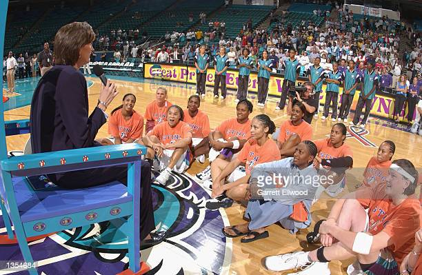 Head coach Ann Donovan of the Charlotte Sting talks to the her team and Sting fans after the game against the Washington Mystics on August 13 2002 at...
