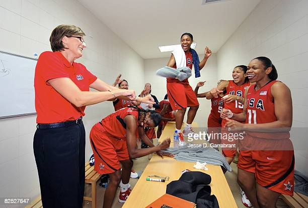 Head Coach Anne Donovan Cappie Pondexter and Tina Thompson of the US Women's Senior National Team celebrate after winning the gold medal against...