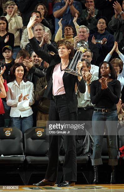 Head Coach Anne Donovan of the Champion Seattle Storm waves to the crowd after being introduced during a timeout at the Atlanta Hawks vs Seattle...