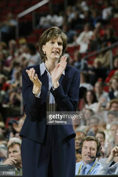Head coach Anne Donovan of the Seattle Storm claps during the game against the San Antonio Silver Stars on June 22 2003 at Key Arena in Seattle...