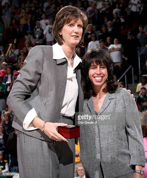Head Coach Anne Donovan of the Seattle Storm receives her 2004 Championship ring from WNBA President Donna Orender prior to the game against the Los...