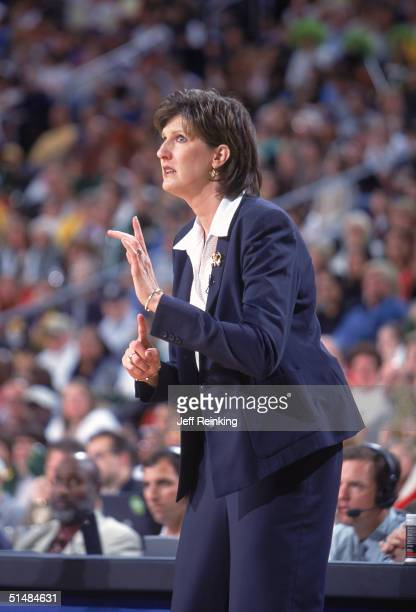 Head Coach Anne Donovan of the Seattle Storm sends signals against the Connecticut Sun in Game three of the WNBA Finals on October 12 2004 at Key...
