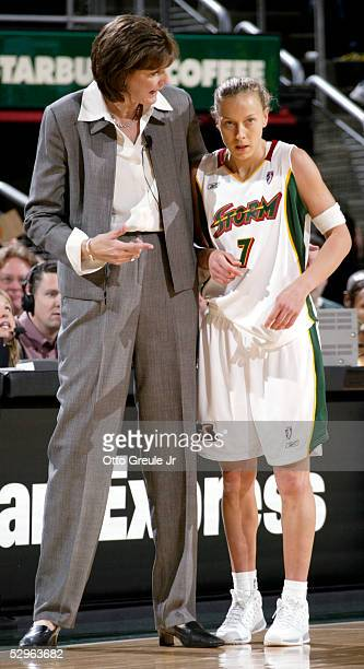 Head Coach Anne Donovan of the Seattle Storm talks to Francesca Zara during a timeout against the Los Angeles Sparks at Key Arena on May 21 2005 in...