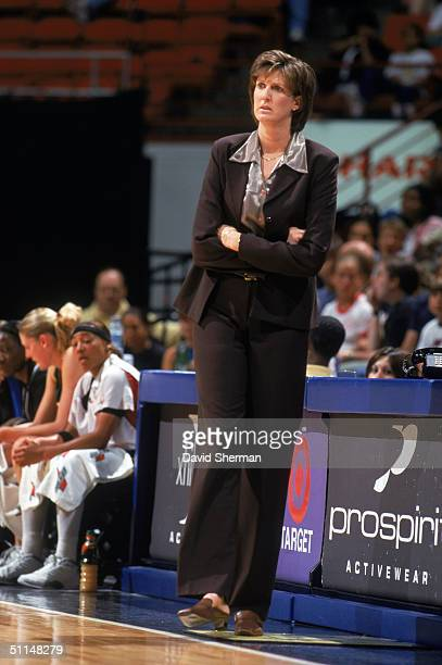 Head coach Anne Donovan of the Seattle Storm walks the sideline during the game against the Minnesota Lynx at Target Center on July 30 2004 in...