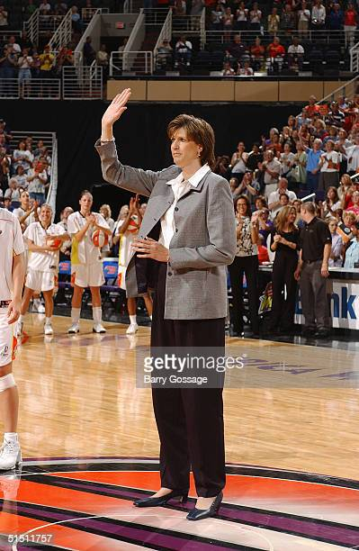 Head coach Anne Donovan of the Seattle Storm waves to the crowd during a WNBA game against the Phoenix Mercury at America West Arena on September 4...